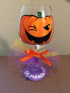 Eat, drink and be SCARY! This sinister pumpkin wine glass holds 18 ounces of your favorite, spooky beverage. Sure to be a hit at your next Halloween party! Also makes a great gift, or party favor. Comes with ribbon shown in picture.  I use high quality glass paints, heat set for durability - Hand washing recommended With special care these glasses will last for years to come!  ***Price is for one wine glass***  ***All glassware is hand painted to order.*** Please see shop policies before…