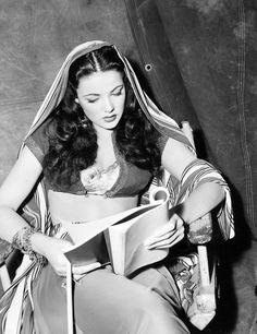 Gene Tierney reading a script. (1941)