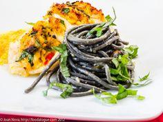 It's a colorful dish> crab-stuffed flounder with yellow tomato saffron sauce + black spaghetti