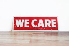 Vintage We Care Sign / Rustic Mid Century Painted Steel Sign / Red With White Wall Art / Beautiful Patina / Modern Industrial Home Decor