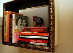 Great idea.  wood box and picture frame= book shelf.