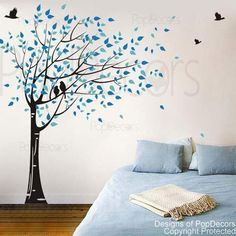Blue leafed tree blowing in the wind with birds wall decal