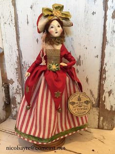 Holly is very festive indeed in her holiday Gown. Her skirt is antique cotton stripe trimmed in hand-dyed velvet ribbon Her bodice i. Paper Mache Clay, Patriotic Decorations, July Crafts, Velvet Ribbon, How To Antique Wood, French Antiques, Fashion Dolls, Art Dolls, Vintage Christmas