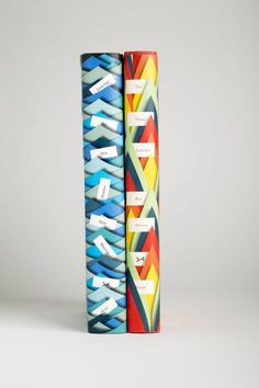 peter mendelsund - Spines Love the paper collage effect of these spines, the coloured paper could be used to represent the chakra colours. Starting at the bottom with red and ending in purple, representing both the colours and positioning of chakra areas on the body.