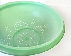 Tupperware colander or strainer jadeite green, I have this in my kitchen cupboard... right now.