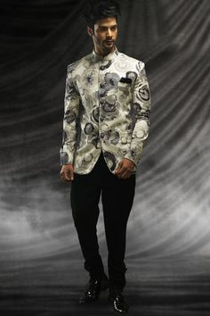 Look like a #prince for your princess on your special day with this #mesmerizing #White jute #sublime prince #suit with standing collar and full sleeves with #cool #print which is ideal for #Parties