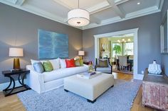 Located on the main living level, the home's living room connects to both the kitchen and the dining room. Home Living Room, Living Area, Edwardian House, Gas Fireplace, Bay Window, Home Remodeling, Hardwood Floors, New Homes, Dining Room