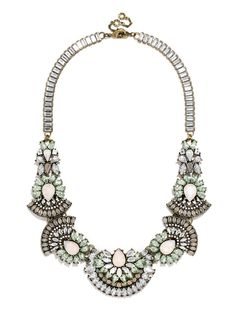 This intricate collar features crystal arcs and floral motifs for a technicolor or moody statement with graphic appeal. #baublebar #swatstyle #statement #necklace