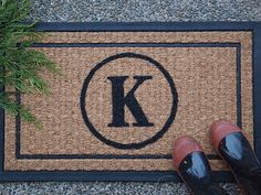 DIY Personalized Door Mat.  (Would probably need to use an oil paint for the rain.)