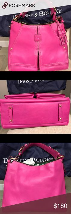 """Dooney & Bourke Large Hobo purse Barely used large Dooney & Bourke hobo bag.  Very little wear, been stored in dust bag.  Lots of storage-interior& front pockets.  11""""H, 16""""W, 6""""D Dooney & Bourke Bags Hobos"""