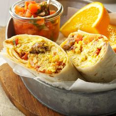 Brunch Burritos Recipe -I like to use a second slow cooker to keep the tortillas warm and pliable when I serve these hearty burritos. Just place a clean wet cloth in the bottom, then cover it with foil and add your tortillas.—Beth Osburn, Levelland, Texas