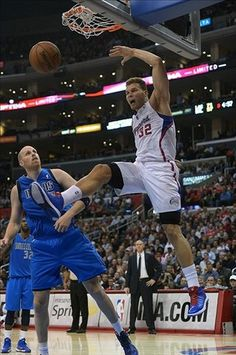 LA Clipper's Blake Griffin adds another dunk to his stats against the Mavericks.