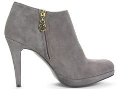 """""""If you carry the bulk of your weight around your thighs, slip on a pair of stature-boosting booties. Easier to walk in and more stable than a pump, this slate-gray suede pair transitions easily from work, to home, to date-night. """"Add monochromatic tights or pants close in color for a slimming effect,"""" suggests Feliciano. If you like them so much that you scoop up a second pair in black, don't say we didn't warn you.""""  Read more: Booties for Pear Shapes - How to Wear Fall Trends"""