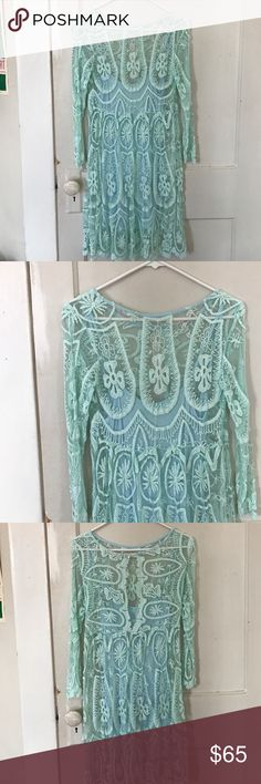 Free people mint lace dress Mint lace dress from free people with slip. Has opening in the back with a button at the top. Only worn a few times Free People Dresses Long Sleeve