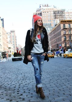 Cold weather street style via Sincerely Jules,  New York, ripped jeans + colorful beanie