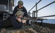 https://flic.kr/p/Q8ivBZ | 170118-N-BL637-084 | PACIFIC OCEAN (Jan. 18, 2017) Master-at-Arms Seaman William Dunn fires an M240B light machine gun as Master-at-Arms 2nd Class Cody Schilcher acts as a safety observer during a weapons qualification gun-shoot aboard the aircraft carrier USS Carl Vinson (CVN 70). The Carl Vinson Strike Group is on a regularly scheduled Western Pacific deployment as part of the U.S. Pacific Fleet-led initiative to extend the command and control functions of U.S…