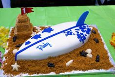 A surfboard cake for a first birthday - the sand castle is the smash cake! Via Just Baked SLO | San Luis Obispo, CA