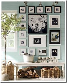 Cute Cute Cute... Love the color on the wall accenting with the black and white prints/frames. Super Cute !!!