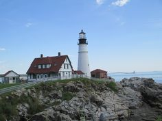"""Portland, Maine.  This is the Portland Head Lighthouse.  Beautiful scenery.  Thankful for a beautiful day but it would have been interesting to see waves crashing on those rocks.   Portland has lots of shops, restaurants and pubs.  """"Shipyard"""" was worth the walk from the pier.  Hope to try the local wine next time."""