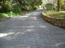 I really like this cobblestone style driveway. It seems that paving your driveway like this would be a good way to make your home seem more elegant. I also like the little retaining wall on the edge of the driveway, that's another really elegant touch.