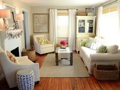 Small Living Room Decorating Ideas With Fireplace A small living room can be a challenge to furnish and decorate justagirl blog i love everything the layered curtains and blinds the inviting sofa the use of space where every area is filled and has a purpose but sisterspd