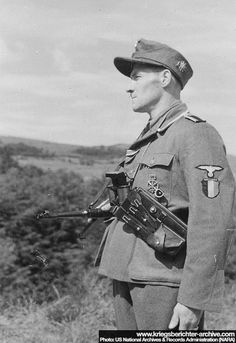 Portrait of a soldier of the 33rd Waffen Grenadier of the SS Charlemagne. The SS Charlemagne are the collective names for units of French volunteers in the Wehrmacht and later the Waffen SS.