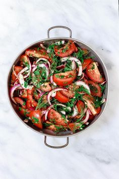 Mediterranean Fresh Herb Tomato Salad   The Mediterranean Dish. Tomatoes and red onions with fresh parsley and dill, doused in citrus and olive oil. Vegan. Gluten-free. Click the image for the recipe and visit TheMediterraneanD... for more healthy recipes!