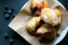These Tasty Zeppole (Italian Donuts) filled with fresh berry compote made from fresh blueberries are easy to make and really delicious.