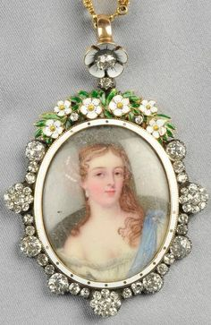 Antique Gold and Enamel Portrait Miniature Pendant and Chain, 19th century. The enamel portrait depicting a Charles II-style beauty, within an old mine-cut diamond and enamel frame of blossoms of flowers, mnounted in silver and gold, signed WB in the counter enamel on the reverse, and suspended from a conforming chain of enamel flower and fancy links. #antique #MiniaturePortrait #pendant