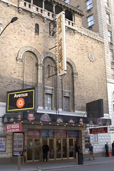 The John Golden Theatre is located on the south side of 45th Street, west of Broadway near 8th Avenue. The facade of the Golden Theatre was part of a single wall of variegated brick with three blind arches. The building was designed in the Spanish Renaissance ...