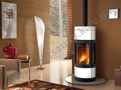 Elegant Pellet Stove For Comfort Your Room Interior Design : Modern Tube Pellet Stove Corner For Living Room With Brown Painting Wall Iincluding Brown Square Pattern Rug On Floor Also Unique Lamp Standing Beside Wooden Wall And Small Table Beside Brown Sofa