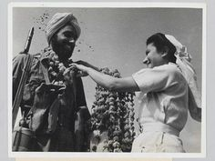A Sikh soldier receives a garland of flowers from a nurse. Italy, World War II. Indiana, British Indian, British Army, Indian Army, Online Collections, Flower Garlands, World War Ii, Wwii, The Past