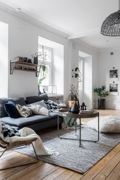 Interior design with a modern rug and a white fur pouf