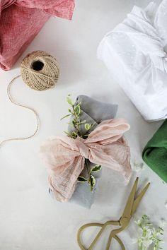 """Learn three different DIY fabric gift wrap methods to make your own reusable fabric """"wrapping paper."""" Includes video tutorial to show you how! Diy Fabric Gift Wrap, Fabric Gifts, Bees Wrap, Diy Home Accessories, Creative Gifts, Diy Tutorial, Gift Wrapping, Wrapping Ideas, Wraps"""