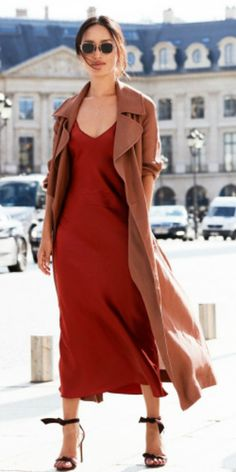 Nicole Warne + gorgeous scarlet slip dress + light brown drape coat + burgundy heels + sunglasses + elegant look.  Dress: KITX, Sandals: Alexander Birman.
