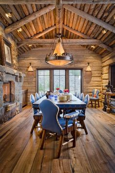 Beautiful log cabin dining by Pearson Design Group