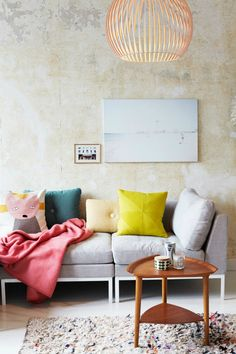 Scandi style living room with yellow cushion, grey sofa and mid century modern furniture