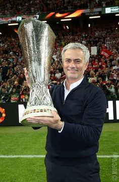 The Special One holds the UEFA Cup, or whatever it's called.