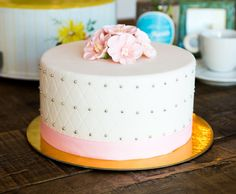 Adorable Cake Topped with Pink Fondant Flowers!