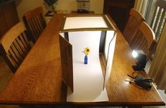 How To: DIY $10 Macro Photo Studio This tutorial is nothing short of fantastic. It shows you how to build a small lightbox in which you take pictures of small objects, flowers or anything you can think of. It won't cost you much: all you'll need is a cardboard box, cutting utensils and some paper.