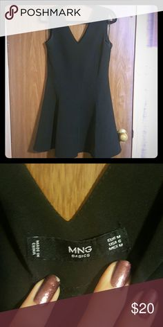 """Black """"skater style"""" Dress LBD Super cute v neck black dress with skater style skirt. Really thick/high quality material. Very cute on! Only wore once. MNG Dresses"""