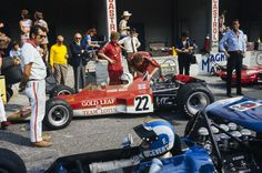 Jochen Rindt, Lotus Ford looks across at François Cevert, March 701 Ford as he drives down the pitlane. F1 Motor, Motor Sport, Jochen Rindt, Lotus F1, Gilles Villeneuve, Indy Cars, Car And Driver, Formula One, Courses