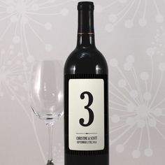 Wedding reception table numbers as wine lables - from wedding star: http://www.weddingstar.com/product/black-pinstripe-table-number-wine-label    http://cdn2.wsstatic.com/images/products/large/1155-31a8216b4a53238084b6bd44b65d6ede629.jpg