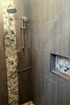 Zen minimalist shower with earth tone and pebble tile walls and floor
