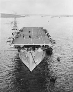 HMS QUEEN moored to a buoy at Scapa Flow.