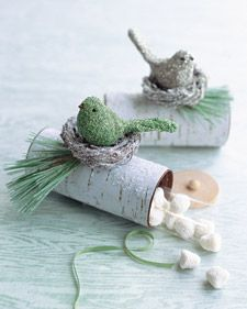 Yule Log Boxes from Martha Stewart - printed clip art of birch bark wrapped around toilet paper tubes.  Wooden disks from Michaels would be the only expensive part... could decorate with ribbon or sprays of pine.  Optional glitter.