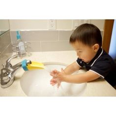 Genius! Aqueduck Bathroom Faucet Extender for your little ones so they can easily wash their hands.