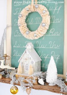 Bottle Brush Wreath with Glitter Putz House on a Vintage Christmas Mantel