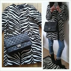 Your Outfit Today » Outfit : Zebra coat and Chanel.  Outfit : Coat : Zara Boots : Zara Boyfriend jeans : 7 for all mankind Bag : Chanel bag 2.55