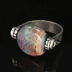 Carol Holaday - Raku Rain ring - lampwork glass bead, tube rivet, roll printed band
